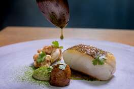 True cod, roasted hen juices emulsified with young garlic, and almond panade at Commis in Oakland, Calif., is seen on March 26th, 2016.