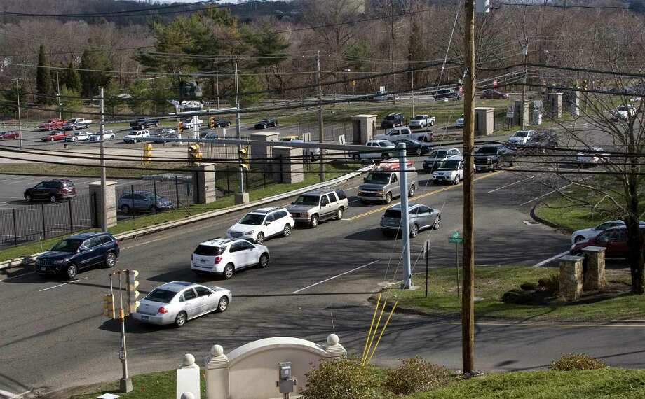 A view of the traffic along Route 110 at Oronoque Lane in Stratford, Conn., on Thursday, Apr. 5, 2018. In the background is the gate to Sikorsky.  DOT will soon realign the gate so it lines up with Oronoque Lane. Photo: Christian Abraham / Hearst Connecticut Media / Connecticut Post