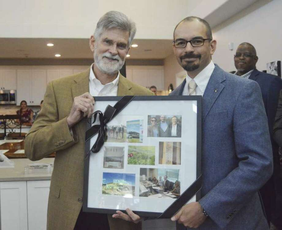 Bill Dalton (left), president of HomeAid Houston and Marco Cordon, director of construction with Lennar/Village Builders, are honored at the dedication of the HomeAid Houston project for Boys and Girls Country.