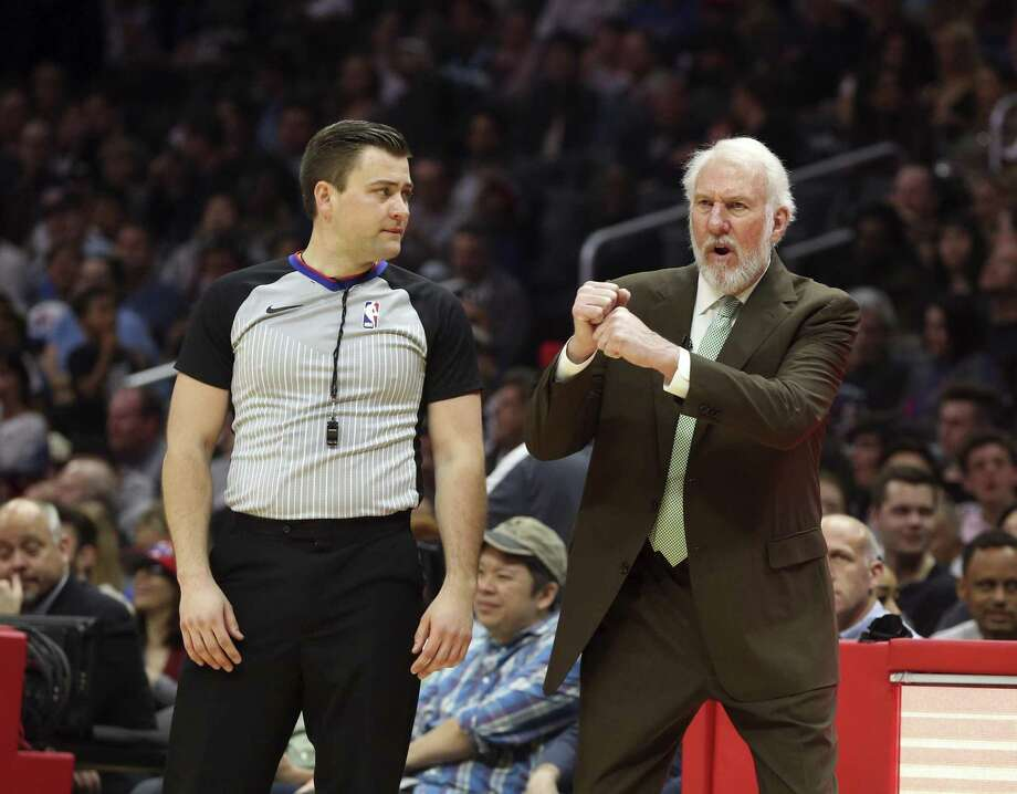 49f5e16c16c San Antonio Spurs head coach Gregg Popovich protests a call by referee  Gediminas Petraitis during the