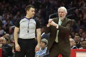 San Antonio Spurs head coach Gregg Popovich protests a call by referee Gediminas Petraitis during the first half of an NBA basketball game against the Los Angeles Clippers in Los Angeles Tuesday, April 3, 2018. The Clippers won, 113-110. (AP Photo/Reed Saxon)