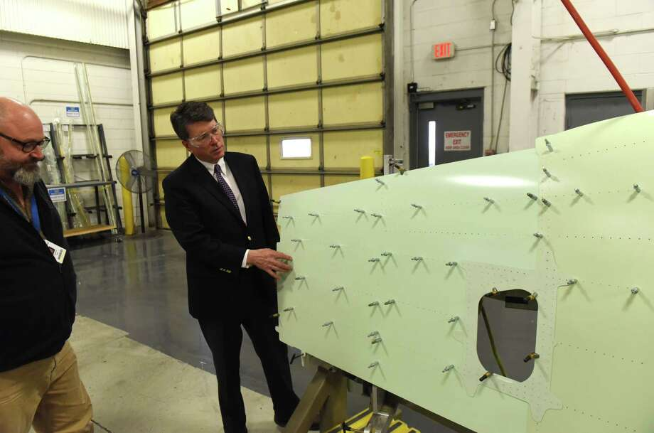 U.S. Rep. John Faso examines a helicopter body panel during a tour of Ducommun Aero Structures on Friday, April 6, 2018, in Coxsackie, N.Y.  (Will Waldron/Times Union) Photo: Will Waldron, Albany Times Union / 20043431A