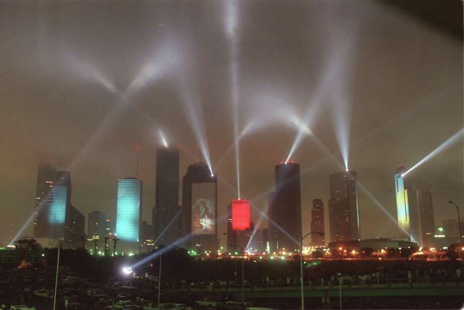 """Laser beams and visual images were projected as high as 70 stories on several Houston skyscrapers. A stunning fireworks display accompanied the performance of """"Rendezvous Houston: A City In Concert,"""" at the Houston International Festival on April, 5, 1986, featured Jean-Michel Jarre's music. Photo: Steve Ueckert, HC Staff / Houston Chronicle / Houston Chronicle"""
