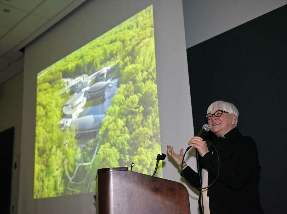 Sandra K. Edwards, Deputy Director of Crystal Bridges Museum of American Art, shows an aerial view of the museum during a presentation about Crystal Bridges at the Bruce Museum in Greenwich, Conn. Monday, April 2, 2018. Located in Bentonville, Ark., Crystal Bridges Museum of American Art provides an all-inclusive educational art experience through variety of American works spanning five centuries, including work from Andy Warhol, Georgia O'Keeffe, Norman Rockwell, Asher B. Durand, John Baldessari, James Turrell, and more. Photo: Tyler Sizemore / Hearst Connecticut Media / Greenwich Time