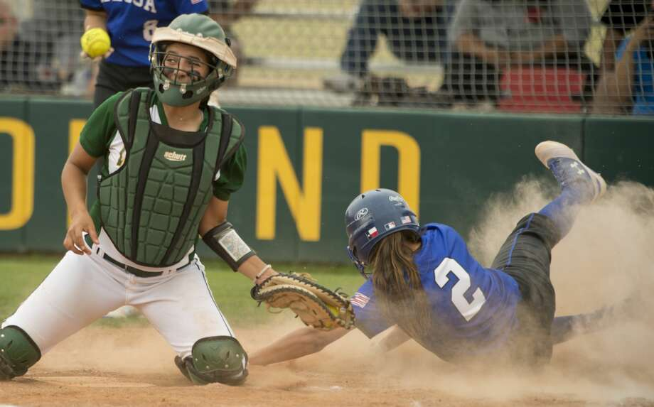 Midland College catcher Mackenzi Hoots can not make the tag on Odessa College's Elizabeth Hickman 04/06/18 for a run during the first game at Midland College field. Tim Fischer/Reporter-Telegram Photo: Tim Fischer/Midland Reporter-Telegram