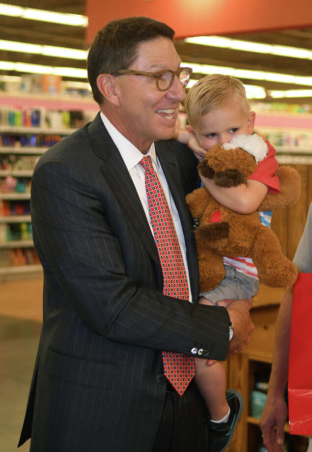 "Scott McClelland, from left, H-E-B President of Food and Drug, surprises three-year-old Carter Smith, of Tomball, with a one-of-a-kind replica of his favorite lost stuffed animal, ""Toby"", that was purchased from H-E-B shelves and lost recently, at the H-E-B Vintage Park Market in Houston on April 6, 2018. (Photo by Jerry Baker/Freelance) Photo: Jerry Baker/For The Chronicle"