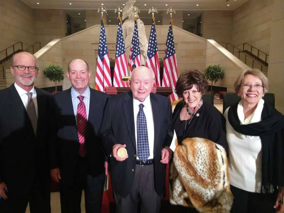 Jack Wheat, center, receives Congressional Gold Medal on behalf of all who served in the Office of Strategic Services (OSS). He is accompanied by his sons and daughters: (L-R) Lee Wheat, Matt Wheat, Stacey Bratton and Hilary Amacker. Photo: Photos Provided By Lee Wheat