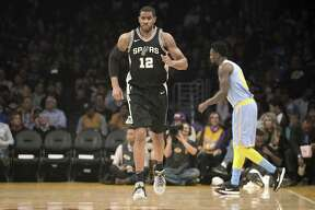San Antonio Spurs forward LaMarcus Aldridge (12) during the first quarter of an NBA basketball game in Los Angeles Wednesday, April 4, 2018. The Lakers won in overtime 122-112. (AP Photo/Reed Saxon)