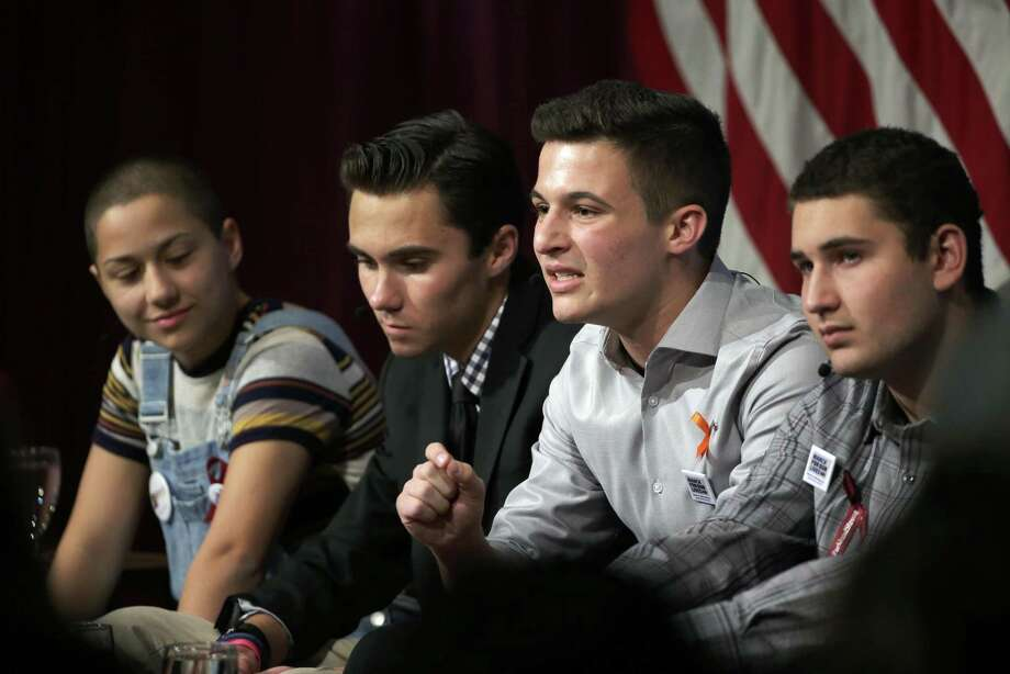 Marjory Stoneman Douglas High School students, and mass shooting survivors, from left, Emma Gonzalez, David Hogg, Cameron Kasky and Alex Wind participate in a panel discussion about guns, Tuesday, March 20, 2018, at Harvard Kennedy School's Institute of Politics, in Cambridge, Mass. The Feb. 14, 2018, attack in Florida killed 17 people, 14 of them students. The students have become vocal advocates for stricter gun laws. (AP Photo/Steven Senne) Photo: Steven Senne, STF / Associated Press / Copyright 2018 The Associated Press. All rights reserved.
