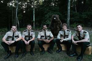 """A still from """"Super Troopers 2"""": L-R: Writers and stars Kevin Heffernan, Steve Lemme, Jay Chandrasekhar, Paul Soter, and Erik Stolhanske, with a furry co-star."""