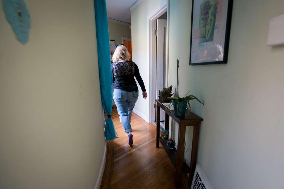 Empty nester Leigh Anne Varney walks through her home in San Francisco's Outer Richmond District. Photo: Sarahbeth Maney / Special To The Chronicle
