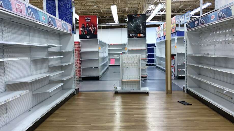 "Empty aisles in the shuttering Toys ""R"" Us in Emeryville seen on April 5. The store is one of two in the Bay Area going down with the first wave of store closures amid the company's liquidation. Photo: Ted Andersen"