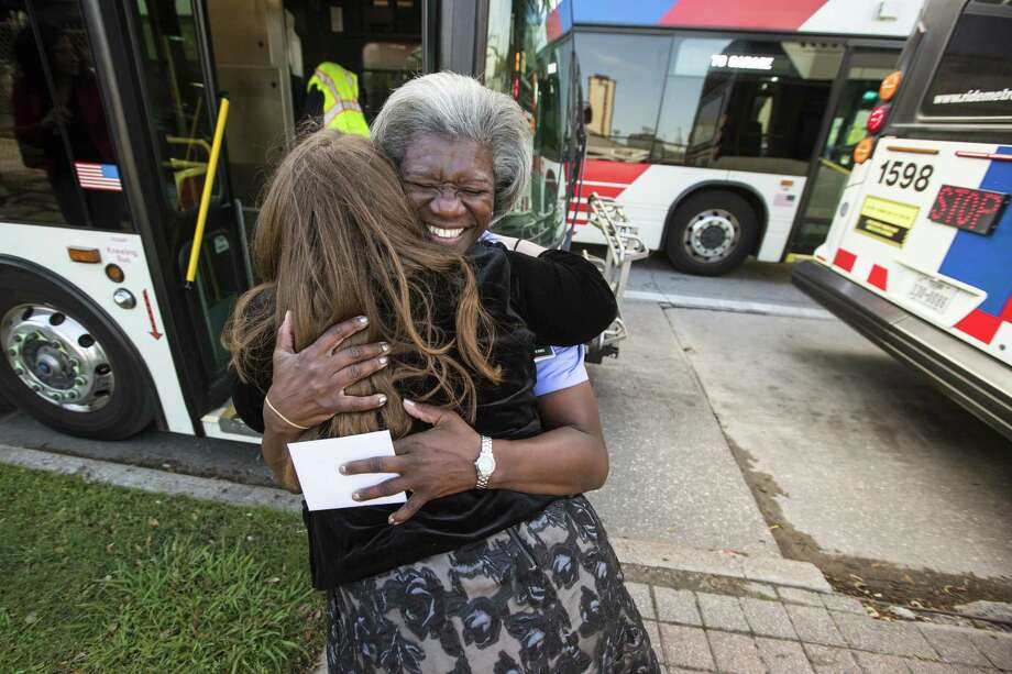 "Bus driver Benita Johnson embraces Maria Town at a layover stop, as Town thanks her for her kindness on April 4. Johnson, a 20-year veteran Metro bus operator and trainer, is drawing acclaim for her treatment of a woman on Easter Sunday, who turned out to be the city's director of the office of people with disabilities. Johnson was strapping Town and her motorized scooter in on Sunday when some riders grumbled how long it was taking. Johnson scolded them and told them they'd be moving along as soon as Town was safe, then told her ""No one's gonna make you feel unworthy when you're on my bus."" Photo: Brett Coomer, Staff / Houston Chronicle / © 2018 Houston Chronicle"