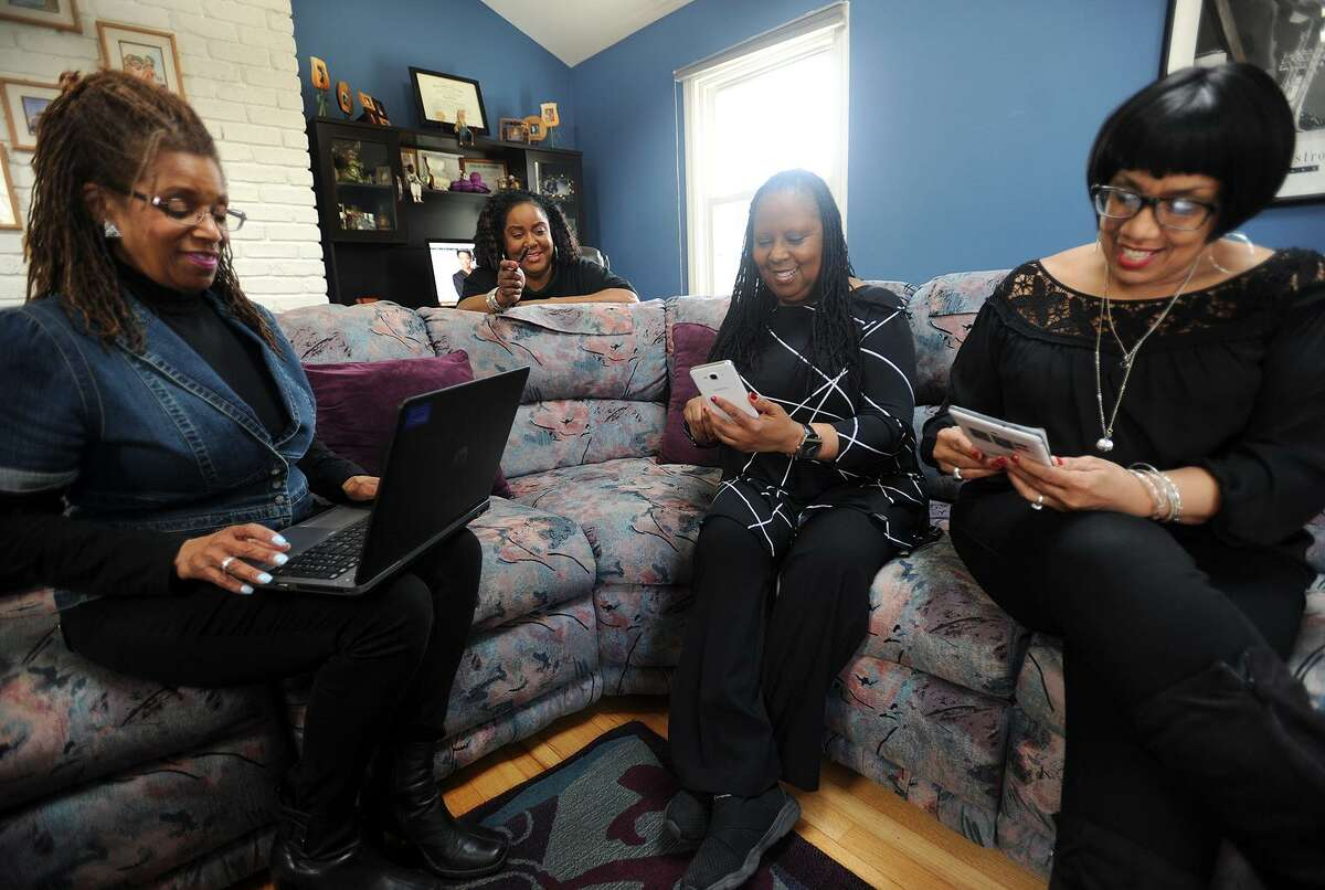 From left; Karen Halliburton, Ruth Manuel-Logan, Angela Kinamore, and Judyth Watson-Remy run their new online magazine, 50Bold.com, from Manuel-Logan's home in Trumbull, Conn. on Thursday, April 5, 2018. The twice monthly magazine was created for African Americans age 50 and over.