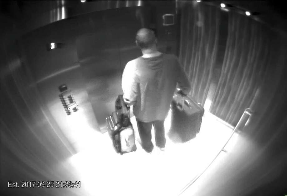 "In this Sept. 25, 2017, security camera image released by MGM Resorts, Stephen Paddock stands with his luggage in an elevator at the Mandalay Bay hotel in Las Vegas. Paddock killed 58 people in Las Vegas, causing many to carelessly and incorrectly use words such as ""crazy,"" making mental illness even more a stigma. Photo: /Associated Press / MGM Resorts"
