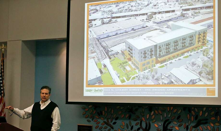 "Xavier Gonzalez, Director of Design GRG Architecture speaks on the proposed Bridge Apartments to be built next to the Hays Street Bridge during District 2 Councilman William H. ""Cruz"" Shaw's Town Hall Feb. 5 at the Heritage Room of the Campus Center Building at St. Philip's College. Photo: /"