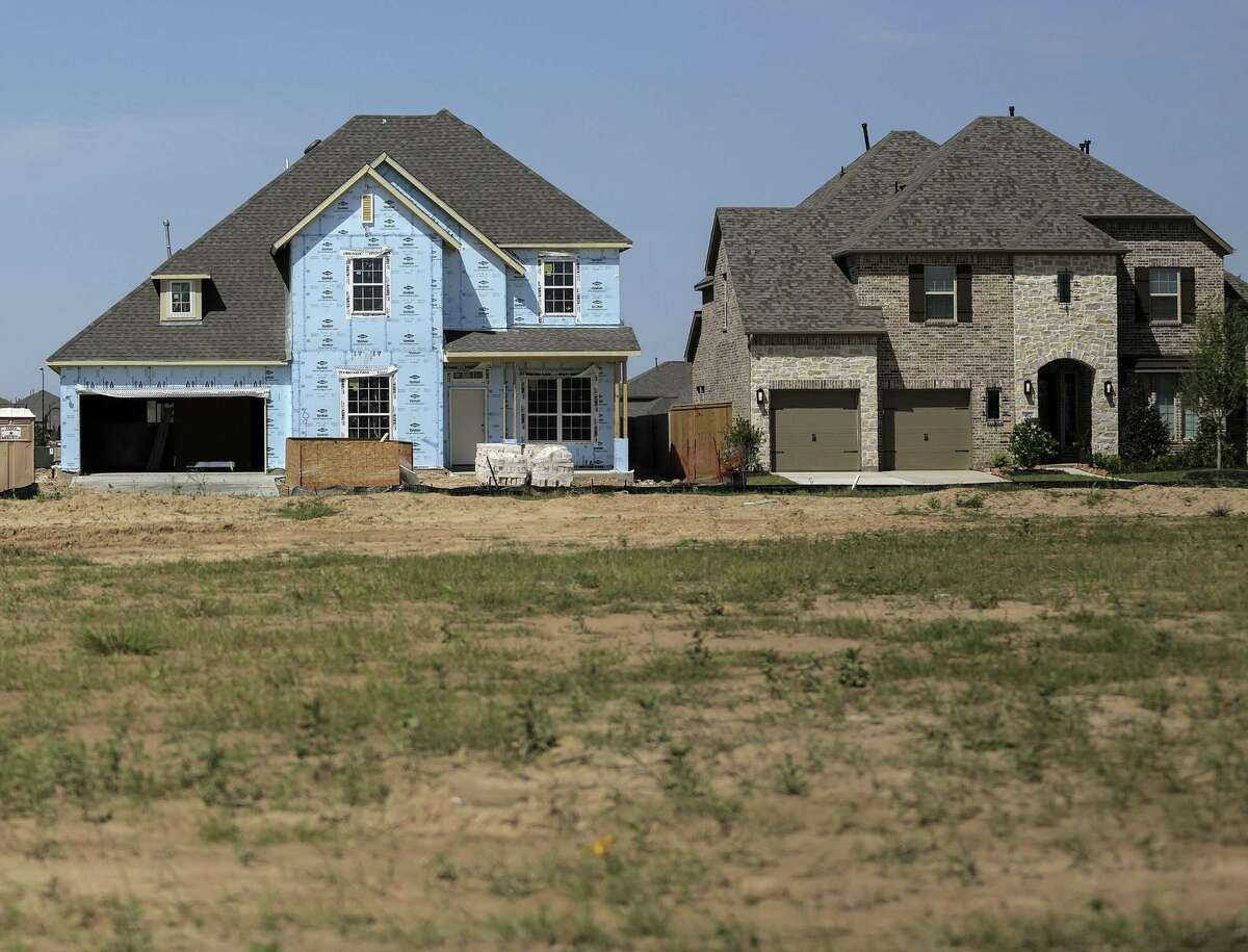New homesin varying stages of construction at Elyson, a new master-planned community in northwest Harris County, photographed on Wednesday, April 4, 2018, in Katy. The developer avoided flood plain regulations by using dirt (fill) to raise the home sites above the level of the flood plain.( Elizabeth Conley / Houston Chronicle )