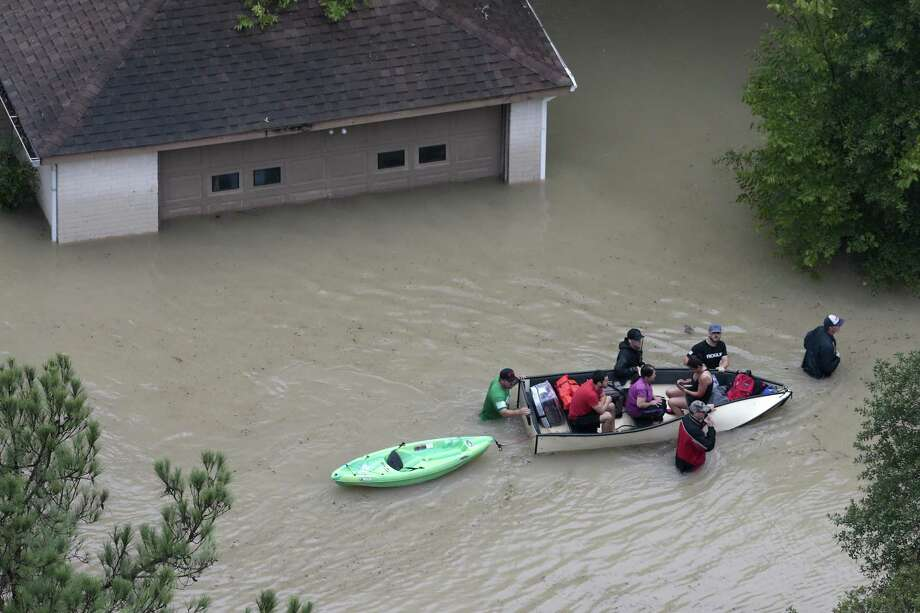 Flood victims are evacuated by boat from their neighborhood near the Addicks Reservoir as floodwaters rise from Tropical Storm Harvey on Tuesday, Aug. 29, 2017, in Houston. ( Brett Coomer / Houston Chronicle ) Photo: Brett Coomer, Staff / Houston Chronicle / © 2017 Houston Chronicle