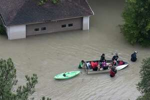Flood victims are evacuated by boat from their neighborhood near the Addicks Reservoir as floodwaters rise from Tropical Storm Harvey on Tuesday, Aug. 29, 2017, in Houston.