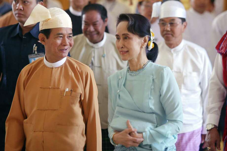 Myanmar State Counsellor Aung San Suu Kyi (right) unfairly takes the brunt of the blame for the nation's stalled democracy. Photo: Thet Aung /AFP /Getty Images / AFP or licensors