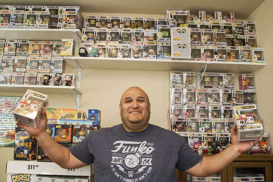 Chris Alva with his collection of Pop! Vinyl figures at his home. Alva estimates he has around 1,000 Funko Pop! figurines. Photo: Alma E. Hernandez / For The Express-News