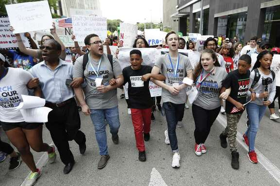 The March for Our Lives protest two weeks ago included 10-year-old Dezmond Floyd of Humble, center, as area students rallied in support of the national movement.