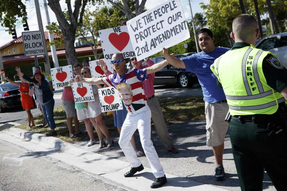 Supporters cheer and wave to the presidential motorcade as it passes along Southern Boulevard in West Palm Beach, Fla., Sunday. Trump has such a hold on the GOP because his views on such issues as trade and immigration are more in sync with Republican voters than the establishment's views are. Photo: TOM BRENNER /NYT / NYTNS