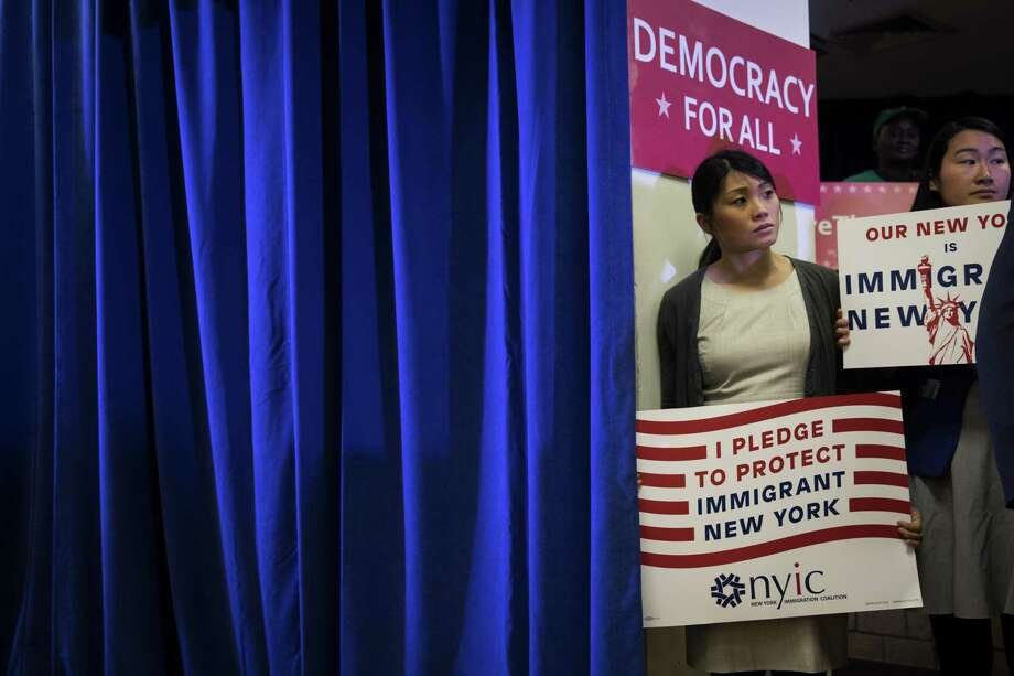 Activists in New York announce a multistate lawsuit to block the Trump administration from adding a question about citizenship to the 2020 census form. Negative attitudes about immigrants among GOP voters is leading party leaders to ignore the consequences of the 2020 census form. Photo: Drew Angerer /Associated Press / 2018 Getty Images