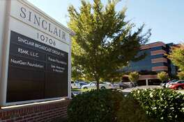 """Sinclair Broadcast Group, Inc.'s headquarters stands in Hunt Valley, Md. President Trump is jumping to the defense of the Sinclair Broadcast Group, which is under fire following the rapid spread of a video showing anchors at its stations across the country reading a script criticizing """"fake"""" news stories."""
