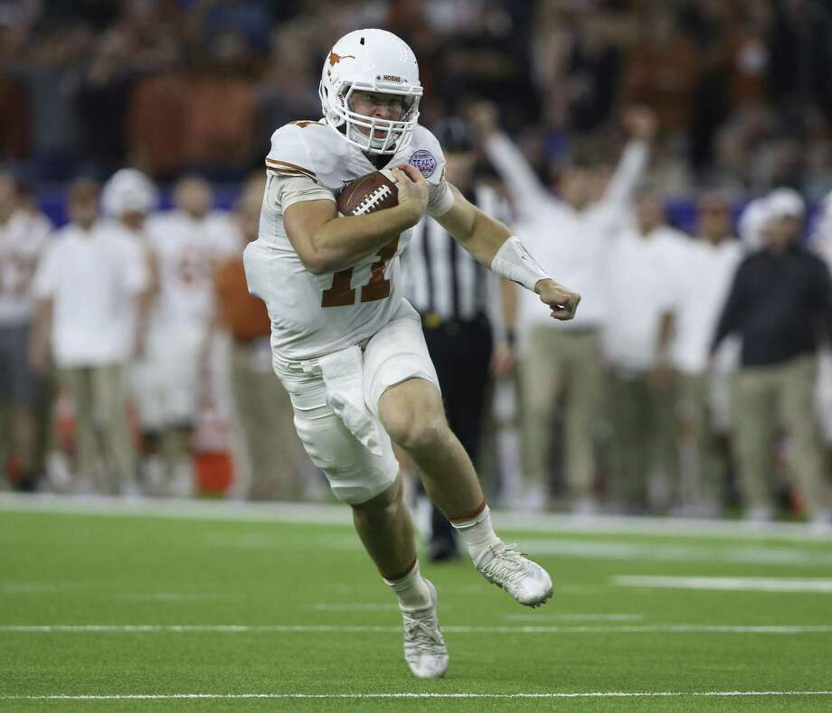 Texas Quarterback Sam Ehlinger runs the ball during the first quarter of the 2017 Academy Sports + Outdoors Texas Bowl game against Missouri at NRG Stadium on Wednesday, Dec. 27, 2017, in Houston. ( Yi-Chin Lee / Houston Chronicle ) Photo: Yi-Chin Lee, Houston Chronicle / Houston Chronicle / © 2017  Houston Chronicle