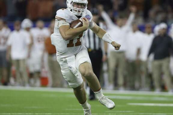 Texas Quarterback Sam Ehlinger runs the ball during the first quarter of the 2017 Academy Sports + Outdoors Texas Bowl game against Missouri at NRG Stadium on Wednesday, Dec. 27, 2017, in Houston. ( Yi-Chin Lee / Houston Chronicle )