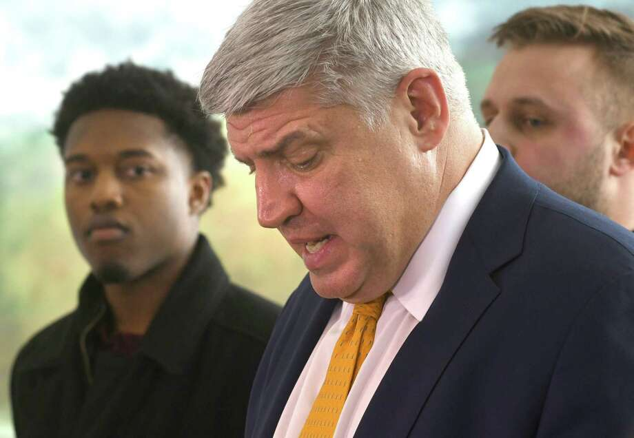 Siena men's basketball coach Jimmy Patsos holds a news conference at Lombardi, Walsh, Davenport, Amodeo law firm to address reports that he verbally abused a team manager on Friday, April 6, 2018 in Colonie, N.Y. Former team managers Wesley Douglas, left, and Robert Sherlock stand behind him. (Lori Van Buren/Times Union) Photo: Lori Van Buren, Albany Times Union / 20043443A