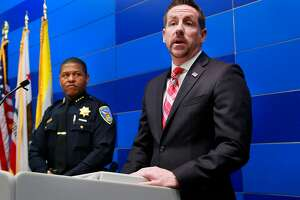 San Francisco Police Chief William Scott, (left) along with Ryan L. Spradlin, special agent in charge for Homeland Security Investigations detail the arrests in six homicides committed between 2006 and 2013,  during a press conference at Police headquarters in San Francisco, Calif., on Fri. April 6, 2018.