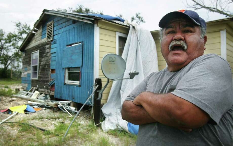 Victor Contreras stands outside the house he grew up in, the same house he rode out Hurricane Harvey in.  The house received heavy damage and Contreras now lives in a trailer which was given to him by a local pastor, otherwise he would be homeless.  Many Rockport residents attend counseling session to help them deal with the stress that has stayed with them from Hurricane Harvey, on Wednesday, April 4, 2018. Photo: Bob Owen, Staff / San Antonio Express-News / ©2018 San Antonio Express-News