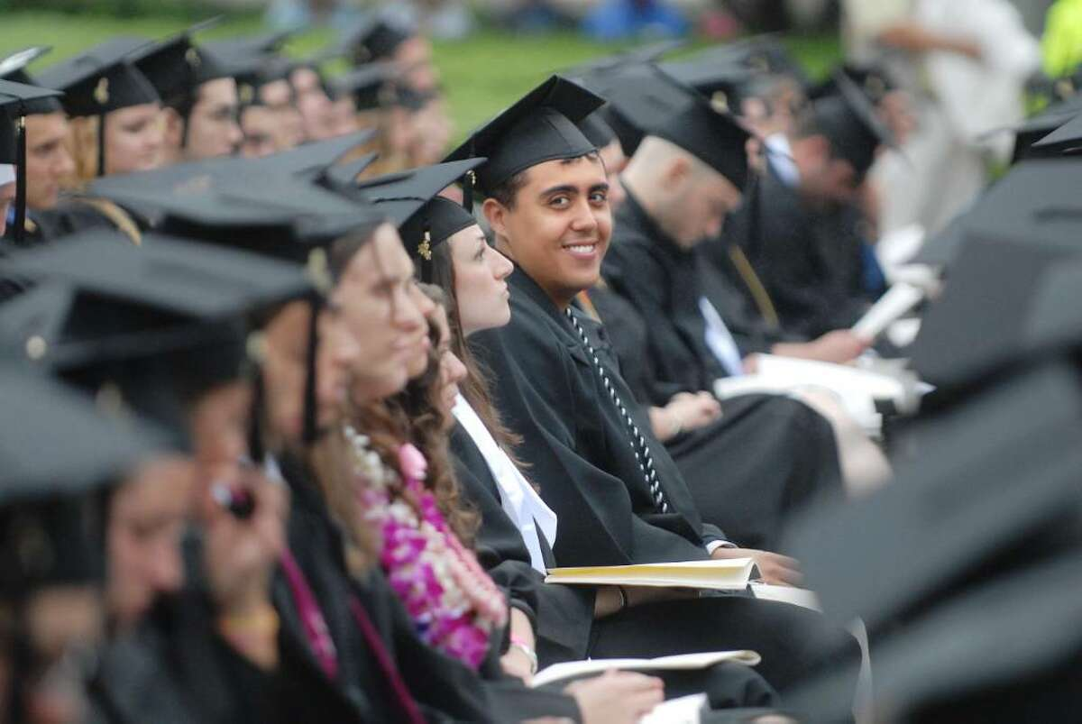 Antonio Gutierrez, Jr., sits with his fellow graduates at the Union College commencement exercises on Sunday, June 13, 2010 in Schenectady. (Paul Buckowski / Times Union)
