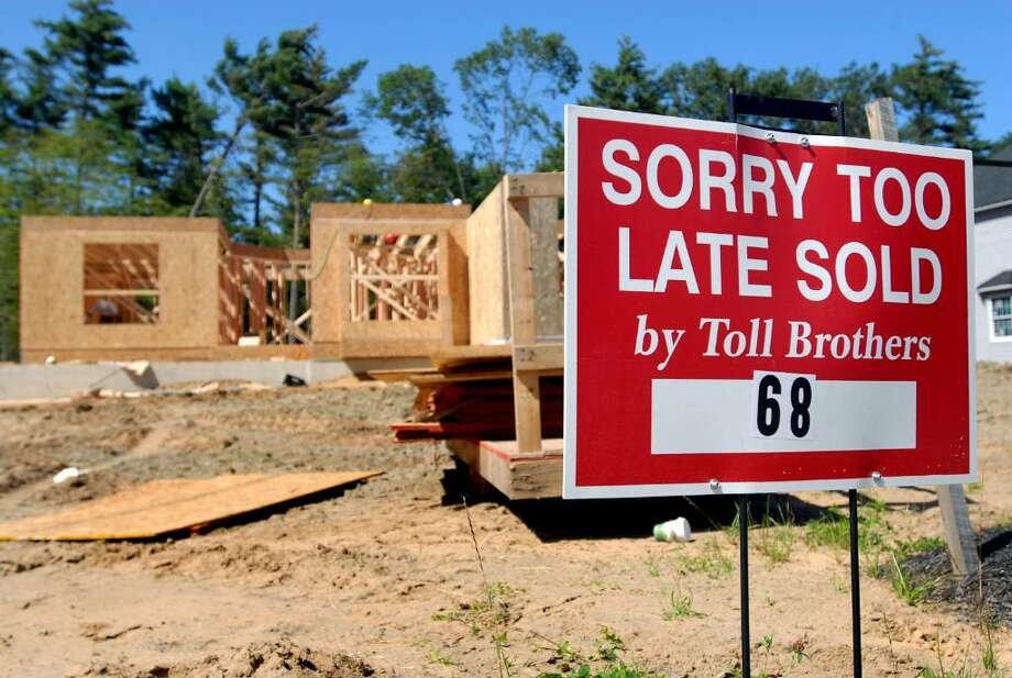 View of a Toll Brothers home under construction on Tuesday, Sept. 1, 2009, at the Estates at Halfmoon in Halfmoon, N.Y. (Cindy Schultz / Times Union) Photo: CINDY SCHULTZ