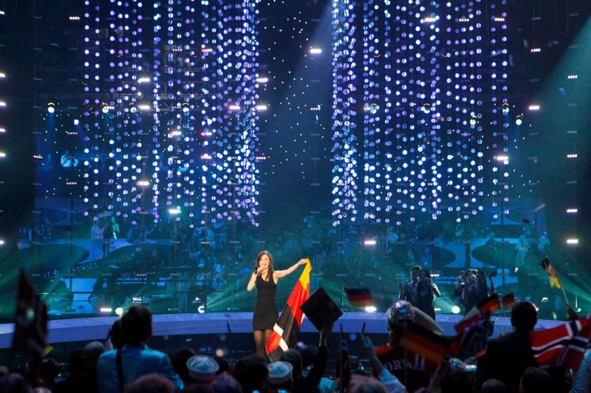 Lena from Germany, center, celebrates after winning the final of the Eurovision Song Contests at the Fornebu Arena in Baerum, near Oslo, Norway on Saturday, May 29, 2010.