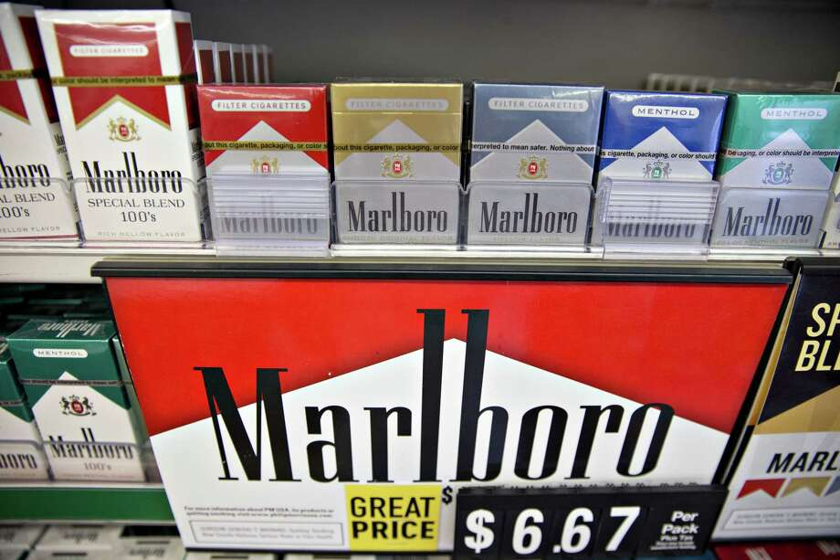 Philip Morris brand cigarettes are displayed for sale at a gas station in Tiskilwa, Illinois, U.S., on Wednesday, July 12, 2017. Philip Morris International Inc. is scheduled to release earnings figures on July 20. Photographer: Daniel Acker/Bloomberg ORG XMIT: 775009733 Photo: Daniel Acker / © 2017 Bloomberg Finance LP