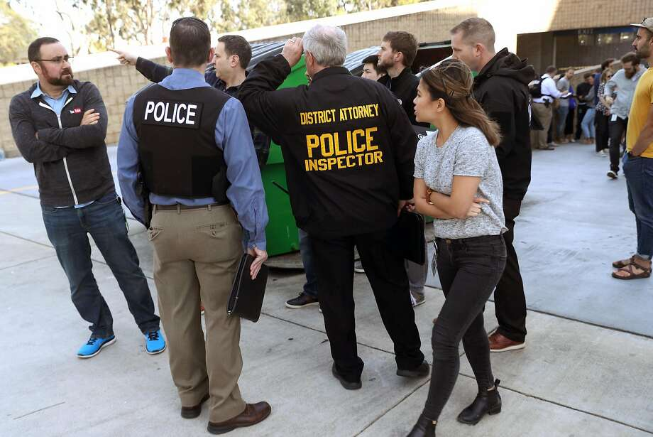 Police direct YouTube employees to a staging area after a shooting Tuesday at the company's San Bruno headquarters. Photo: Scott Strazzante / The Chronicle