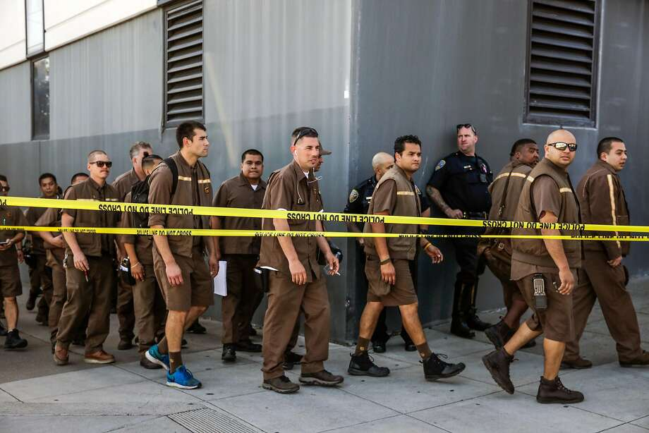 UPS workers evacuate their building after a shooting rampage in San Francisco on June 14. Since then, the company has tightened its policies on metal detectors and bag checks, several workers said. Photo: Photos By Gabrielle Lurie / The Chronicle 2017