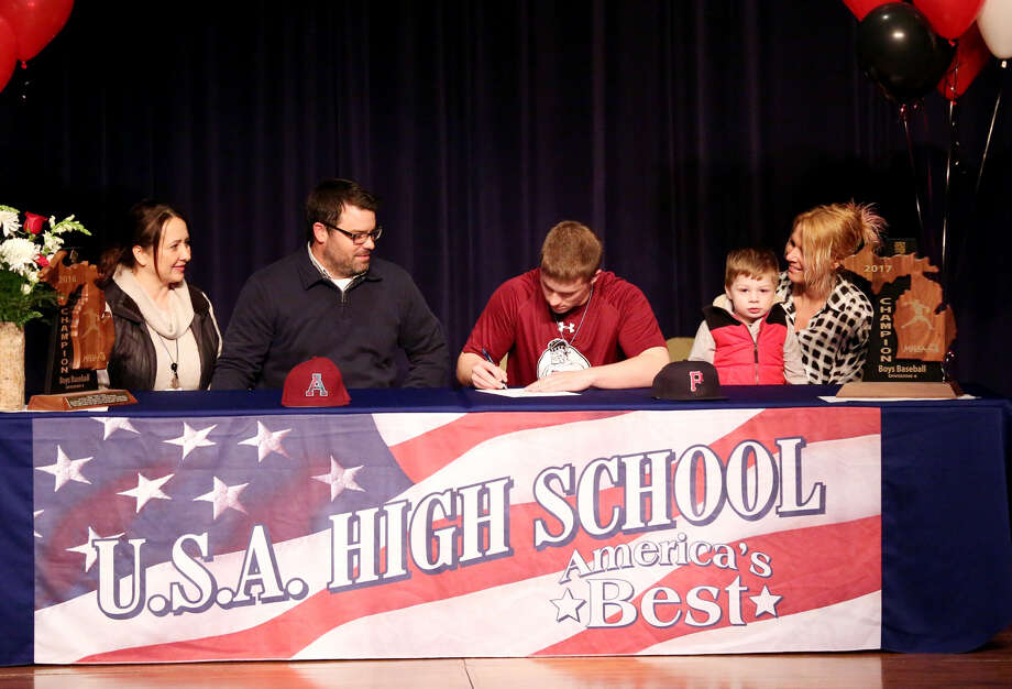 USA standout catcher Cooper Kauffold signs his letter of intent to play for Alma College, Tuesday at USA. He is joined by (from left) step mom Katrina Kauffold, dad Matt Kauffold, mom Nicole Weber and brother Finn Priebe. (Paul P. Adams/Huron Daily Tribune)