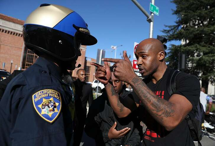SACRAMENTO, CA - MARCH 22:  A California Highway Patrol officer is confronted by a Black Lives Matter protesters during a demonstration on March 22, 2018 in Sacramento, California.  Hundreds of protesters staged a demonstration against the Sacramento police department after two officers shot and killed Stephon Clark, an unarmed black man, in the backyard of his grandmother's house following a foot pursuit on Sunday evening.  (Photo by Justin Sullivan/Getty Images)