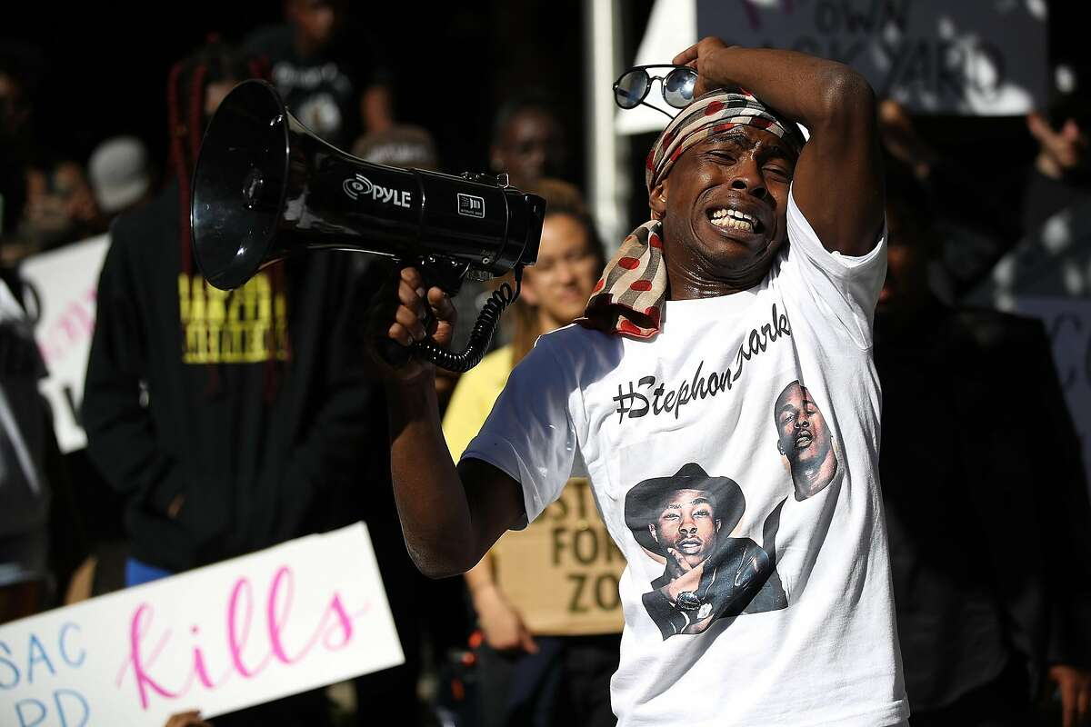 SACRAMENTO, CA - MARCH 28: Stevante Clark, brother of Stephon Clark, speaks during a Black Lives Matter protest outside of office of Sacramento district attorney Anne Schubert on March 28, 2018 in Sacramento, California. As mourners attended a wake for S