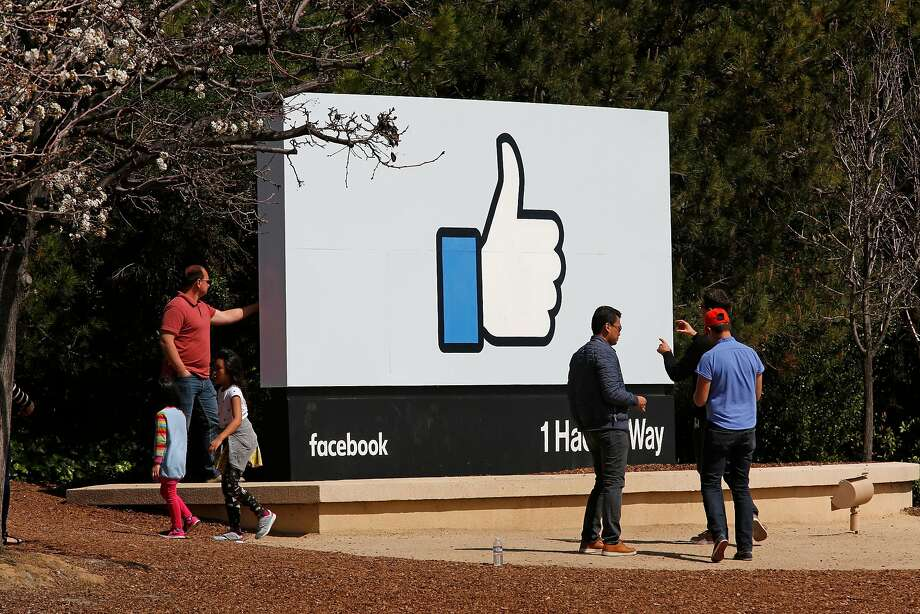 FILE-- Visitors stop for photos at the Facebook sign, but many are now wary about sharing information on the social network. Facebook has begun to make changes after revelations that the political consulting firm Cambridge Analytica had improperly harvested the data of up to 87 million users. Photo: Michael Macor / The Chronicle