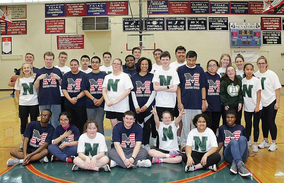 The first-ever Unified Basketball game played by cross town rivals Norwalk and Brien McMahon was held last week at Kehoe-King Gym in Norwalk. The Bears, coached by Dan Barret and Jessica Ireland, faced the Senators, coached by Amanda Bolz and Kelsey Murphy, played two 20-minute halves and when the final horn sounded the two rivals had played to a 68-68 tie. All involved hope this was only the beginning of a long standing tradition between the two Unified Programs. The students were awarded with medals and a pizza party at the end of the game. Photo: Contributed Photo
