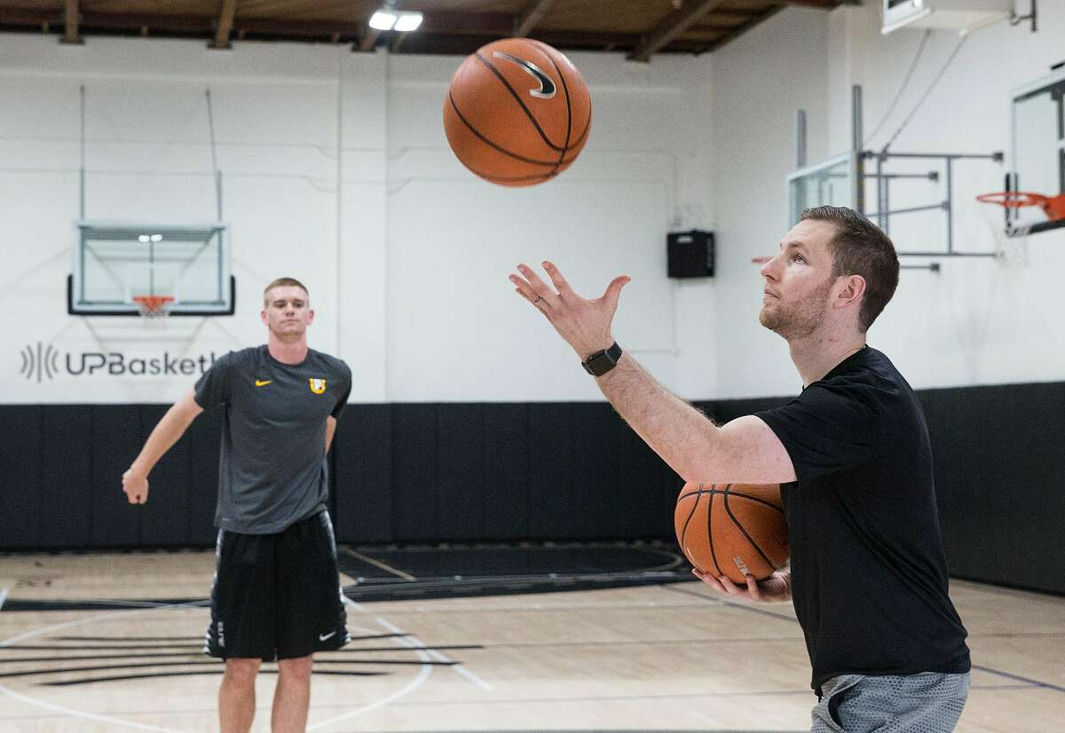 Trainer Packie Turner, right, runs drills with Los Gatos High School basketball player Dylan Belquist at the UPBasketball training facility Thursday, April 5, 2018 in Burlingame, Calif.