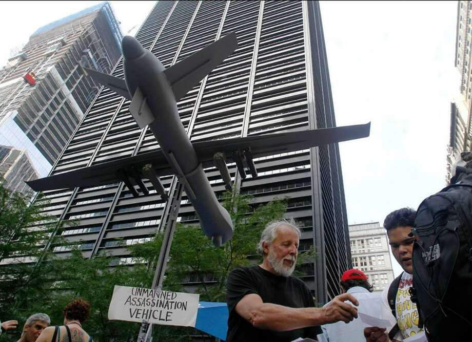 Nick Mottern, an anti-war activist, displays a mock-up of a military drone at a recent demonstration in New York City. Photo: / Contributed