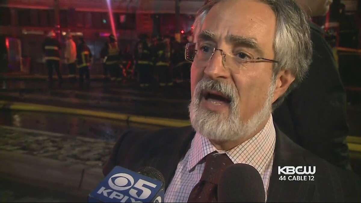 San Francisco Supervisor Aaron Peskin speaks to reporters at the scene of a major fire in North Beach on� March 17.�� Fire department officials claimed he was
