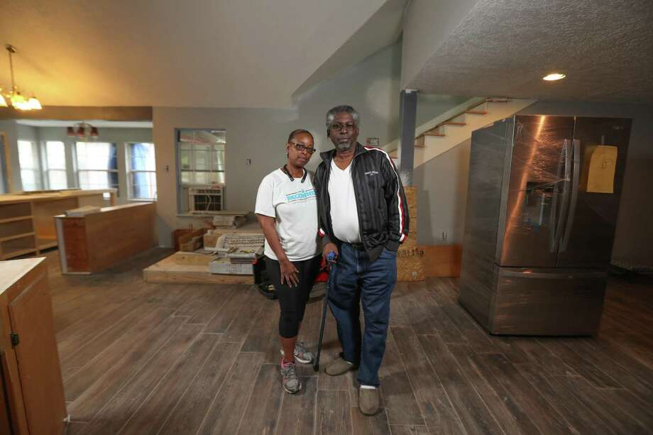 Tyrone and Carolyn Brown are rebuilding their home near C.E. King High School, Thursday, April 5, 2018, in Houston, after Hurricane Harvey destroyed it. Tyrone is being treated for cancer and they are now relying on tens of thousands of dollars in low-interest loans to repair their home. ( Steve Gonzales / Houston Chronicle ) Photo: Steve Gonzales, Houston Chronicle / Houston Chronicle / © 2018 Houston Chronicle