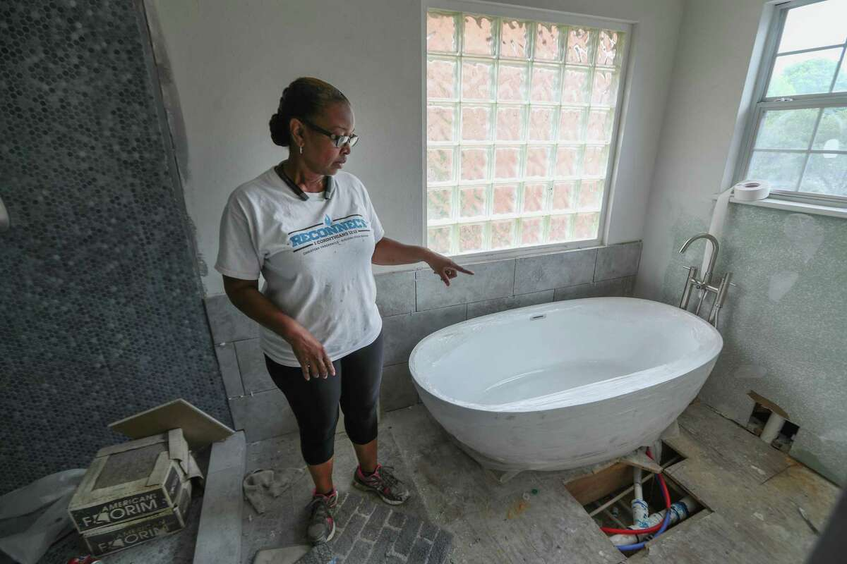 Carolyn Brown looks at her bathroom that is not completed, Thursday, April 5, 2018, in Houston. Her husband, Tyrone, is being treated for cancer, are now relying on tens of thousands of dollars in low-interest loans to repair their home that was destroyed by Hurricane Harvey. ( Steve Gonzales / Houston Chronicle )